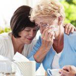 Senior women consoling their friend